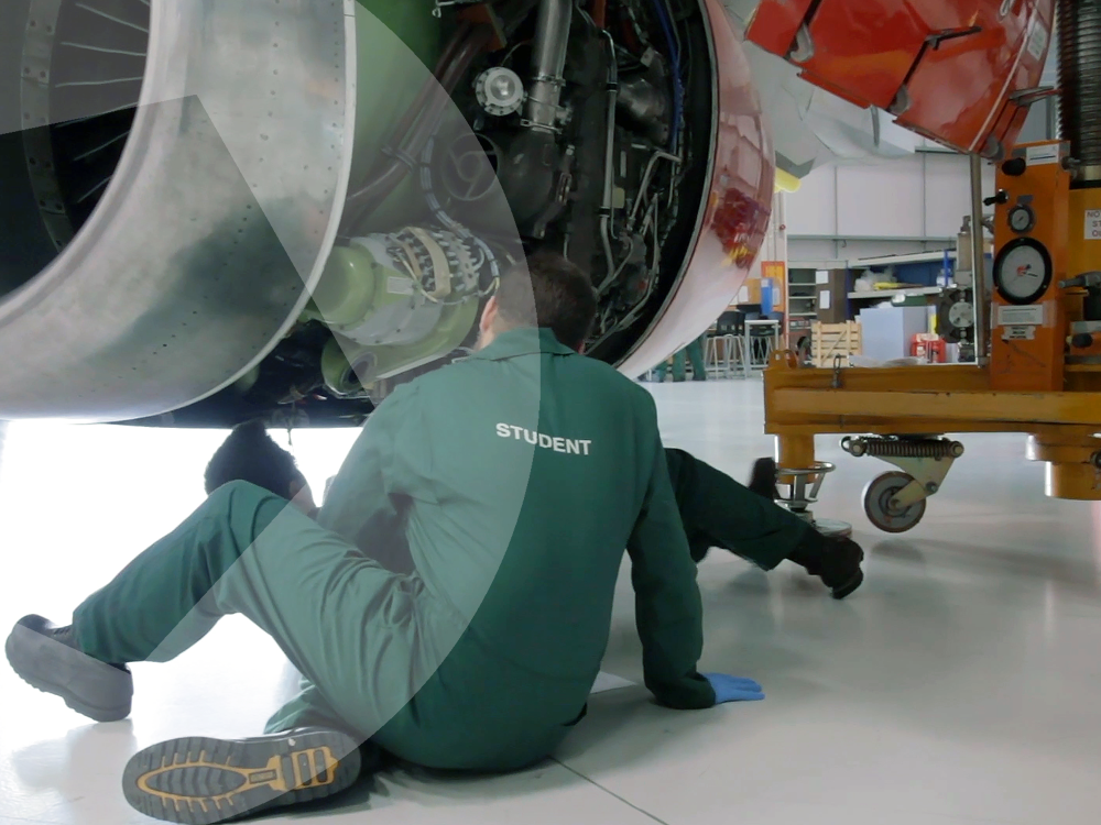 Aviation apprentice working on plane