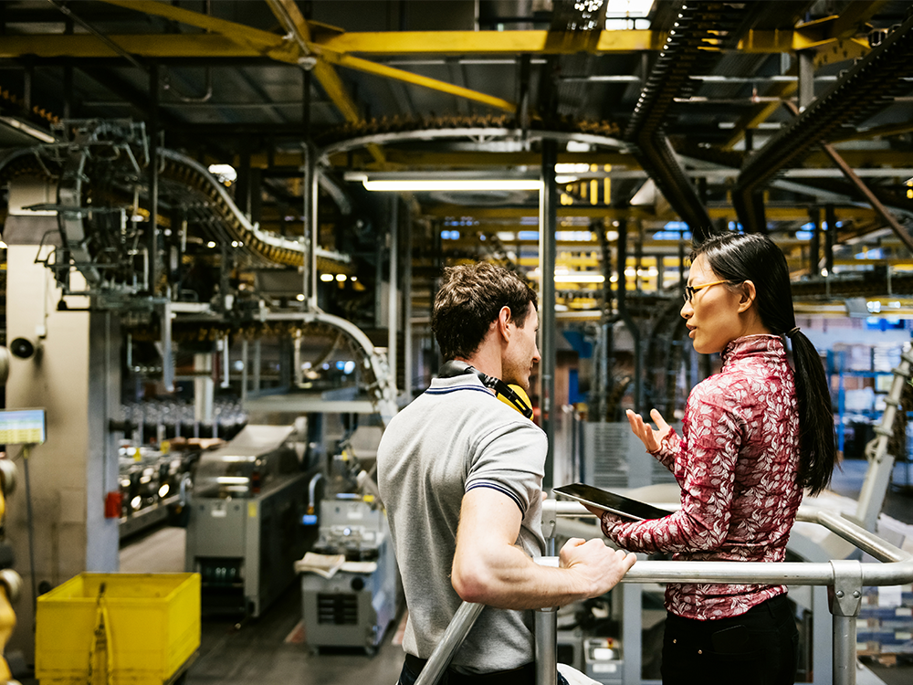Man and woman in a manufacturing area