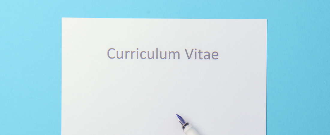 blank cv with pen on blue background